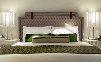 Accessible king deluxe room bed head with green accent pillows and two nightstands adjacent to headboard